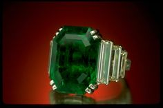 Maximilian Emerald, designed by Cartier, at the Smithsonian's National Museum of Natural History. Worn by Marjorie Merriweather Post for her presentation at the Court of St. James in 1929.