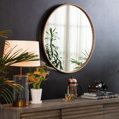 This circular accent mirror is eye-catching and makes your reflection a little fancier whether you're dressed for cocktails or the gym. Measuring 30'' in diameter, it features a classic twisted rope frame made of metal with a metallic finish for a modern twist. Mount this piece to the wall in your hallway above the sideboard for a touch of passing glam, or above the dresser in your master bedroom for a traditional focal point. This mirror's round, classic yet contemporary design complements ever Modern Buffet, Bright Homes, New Living Room, Round Mirrors, Home Decor Outlet, Home Decor Inspiration, Frames On Wall, Modern Contemporary, Decor Styles