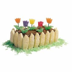Mother's Day recipe / craft: Decorate a store bought pound cake with gumdrop tulips and a fence made of lady fingers.