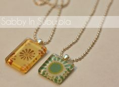 Homemade Pendant Necklaces from glass marbles.  Use pretty patterned paper–thicker is a better, flat-bottomed glass marbles–the ones in the floral department at Michael's, E-6000 glue, circular paper punch, strong round magnets.