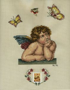 I cross-stitched one of Raphael's cherubs for a three ring binder cover. At the bottom I added a US. postage stamp from the same painting.