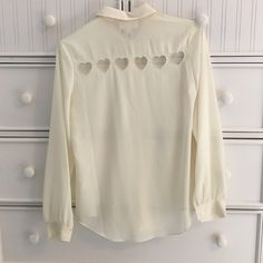 Cream, button up blouse Size medium, cream button up. CUTE cut out hearts on the back. Worn only once or twice. Make an offer :) L'atiste Tops Blouses