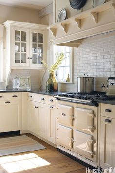 an Aga range works beautifully with the kitchen's spare aesthetic.