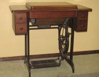 Sewing Machine. My mom had a Singer sowing machine, almost identical to this.....I still remember.