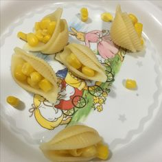 """Feeding fussy eaters is hard work. ⠀ ⠀ It's something I've written about before.⠀ ⠀ Two of my suggestions were:⠀ ⠀ 1. Change the food into fun shapes ⠀ 2. Give the food interesting names. ⠀ ⠀ This picture shows part of tonight's dinner """"Corn Boats"""" or """"Seed Pods"""". Just corn put into noodles. And you won't believe it - there was a fight over the last one."""
