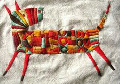 this is such a colourful cutie. Colourful embroidery with geometric pattern. But what animal is it meant to be? Dog?