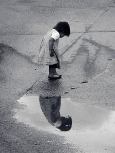 """Did you ever wonder if the person in the puddle is real, and you're just a reflection of him?""  ~Bill Watterson ..*"