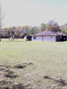 Solid Built Concrete Block/Stucco 3/2 Home on 2.99 Acres, Zoned A-1. Great Split Plan of 2000 SF LA w/ Foyer, Eat-In Kitchen, Large Sunny Breakfast Nook, Dining Room, Living Room, Family Room, & Vinyl Enclosed Sunroom, Oversized 2 Car Garage. Also on Property Are Two Storage Sheds. Seller States: HVAC New, Roof About 10 Years, Septic Pumped 1-2 Years Ago. Great Location Very Close to The Villages & Lovely Farms. Ready for Immediate Occupancy - Bring Your Horses, Animals. ML514859