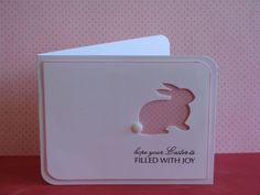 handmade Easter card: CAS Poppystamps Grand Bunny layered over distressed dot paper with foam tape after edging the card with pink marker. Add the sentiment and a pompom as a bunny tail.
