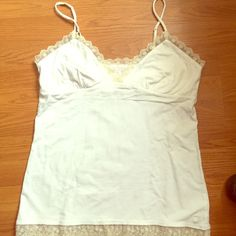 American Eagle camisole Gently worn camisole with lace border on top and bottom!  Can be worn by itself  for pleasure or under a blazer for work! In great condition and open to offers  American Eagle Outfitters Tops Tank Tops