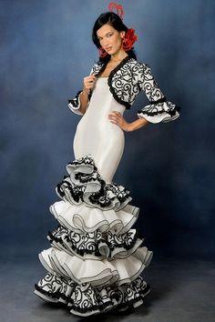 spanish flamenco dresses | Seductive and elegant classics design created with white taffeta and ...