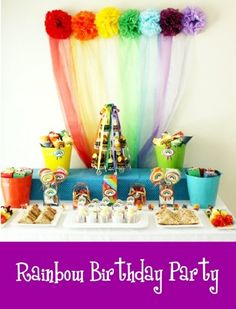 Love this kids rainbow party treat table, especially the pom pom backdrop!
