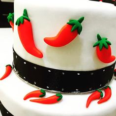 edible fondant chilis on top of a cake! #edible #fondant #chili #black #red #green #white #cake #handcraftededibles