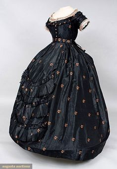 BLACK & PEACH SILK BROCADE BALLGOWN, 1865-1875 ~ Black ribbed taffeta brocaded with widely scattered peach floral sprigs, trimmed with white silk bobbin lace, wide scoop neckline, short sleeves trimmed with blonde lace & bias silk, fitted boned bodice, lined with muslin.  Center front glass button closure. Three swagged flounces of pinked self fabric at skirt front.