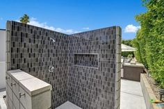 Designed by architect William Krisel, who's well-known in Palm Springs' modernism design circles, and fresh off a renovation, this three-bedroom A-frame boasts an outdoor shower with gray-and-black tiling. Other backyard perks include a built-in fire pit, raised spa, and outdoor kitchen.