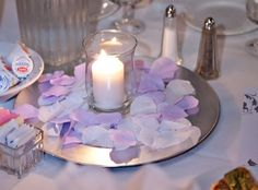 Planning a wedding on a budget? Save hundreds -- or even thousands -- of dollars by making your own reception centerpieces. This article gives you ideas for creating centerpieces that cost as little as five dollars each!