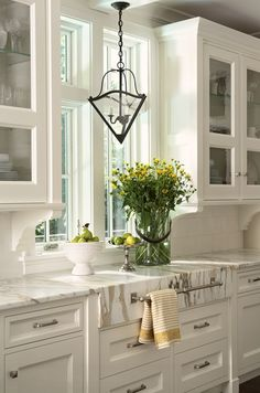 Corbels mounted under cabinets on each side of the sink.  Lovely kitchen detail.