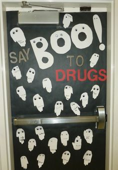 Say Boo to Drugs door with handprint ghosts - Red Ribbon Week - Light Bulbs and Laughter.