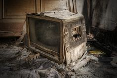 Abandoned TV in rundown house