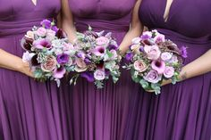 "The Bridesmaid's Bouquets matched their deep purple ""Two Birds"" gowns and included different shades of purple and aubergine Calla Lilies with Senecio, Roses, Eucalyptus and Peppermint"