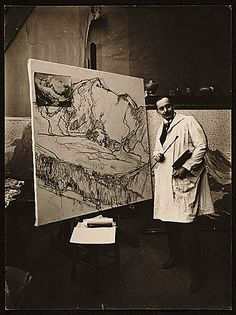 Here is Edgar Payne in his studio when he lived in Paris in the 1920's–working from a photograph.