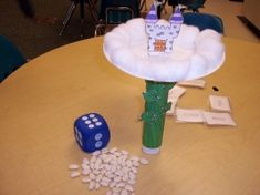 Castles in the Sky  A game I made that can go with Nursery Rhymes too. The children take turns rolling the dice and then place that many magic beans (lima beans) carefully on the plate trying not to tip it over. Keep playing until the castle topples down. This is not an original idea - I got it from makinglearningfun.com I believe.