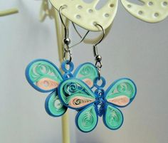 Bespoke silver/ stainless steel handmade quilling by Hiquilling Quilling Butterfly, Paper Quilling Flowers, Quilled Paper Art, Paper Quilling Designs, Quilling Paper Craft, Quilling Patterns, Blue Butterfly, Quilling Ideas, Butterfly Earrings