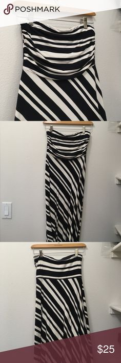 Strapless striped maxi dress Diagonal black and white stripe maxi dress. Ruching and thick fabric on the chest. Banana Republic Dresses Maxi