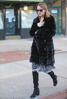 Stepping out: She added racy knee-high black boots to her perfect winter ensemble