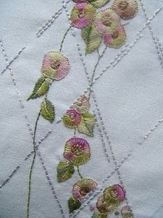 Embroidery. Stitchery Jen. Block of Brenda Embroidery Design's Jane Austen Quilt. These are the little flowers behind the window pane.