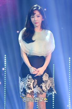 Browse SNSD TaeYeon's official pictures from Music Core