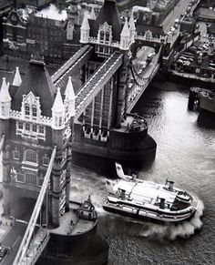 A hovercraft passes under Tower Bridge in London in the 1970s.