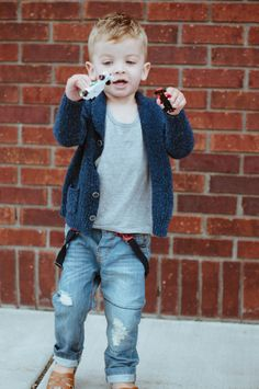 Kids ard kids, not small adults, look at his suspenders... so many chances to hook sth. IT'S KID!!!!