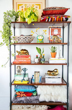 Learn how to decorate a shelf on your bookcase or a floating shelf in your living room. The experts at domino share ideas for styling shelves in your home. Bookshelf Styling, Bookshelves, Bookshelf Organization, Storage Shelves, Muebles Living, Decor Inspiration, Deco Boheme, Blog Deco, My New Room