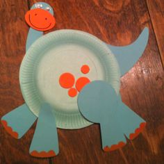 Paper plate dinosaur! Cute for The Bug Circle or Mr. Bones.