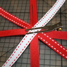 making a loopy flower bow by curling ends back to center. Make layers and stack.