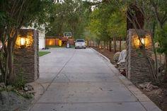Outdoor Update: Stacked Stone, Pillar Lights & Progress - simply organized