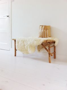 It only takes one sheepskin throw to bring the cozy into a stark space.