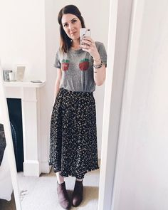 Midi pleat floral skirt by Zara. NYC Tee by Urband Outfitters. Boots by Florence & Fred at Tesco. - Hannah 🌿 (@hannahandtheblog)