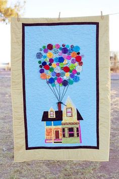 """from 24 blocks - Alison Brewer: """" made this Up quilt for my new niece that is currently in the NICU. Her mom helped sew the yo-yos. I created a pattern for the house (paper pieced pattern) and used 3 different sizes of yo-yos for the balloons. This was a GREAT scrap buster project! The yo-yos were all from my scrap pile!"""""""