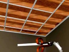 This surface mount ceiling grid can be installed in any room. The grid system mounts to ceiling joists or any other ceiling surface and does not require wire. Low Ceiling Basement, Home Ceiling, Basement Walls, Basement Flooring, Ceiling Tiles, Basement Ideas, Drop Ceiling Grid, Dropped Ceiling, Basement Makeover