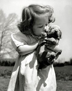 """""""Puppy love is evident as Christina Goldsmith, 2 ½, kisses a young acquaintance. The Weimaraner makes a good household pet and an excellent watchdog."""" - LIFE magazine, June 12, 1950. (Bernard Hoffman—The LIFE Picture Collection/Getty Images) #wildLIFEwednesday"""