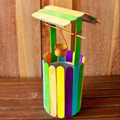 Construct a Mini Colorful Wishing Well - Crafts - Guidecentral. Guidecentral is a fun and visual way to discover DIY ideas, learn new skills, meet amazing people who share your passions and even upload your own DIY guides. Popsicle Stick Houses, Popsicle Stick Crafts, Craft Stick Crafts, Fun Crafts, Crafts For Kids, Arts And Crafts, Paper Crafts, Craft Ideas, Diy Ideas