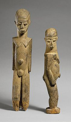 Shrine Figures: Couple (Bateba Phuwe)  Lobi, Burkina Faso  Wood; male: H. 57.2 cm (22 1/2 in.); female:   H. 46.4 cm (18 1/4 in.)  20th century  Thomas G. B. Wheelock Collection
