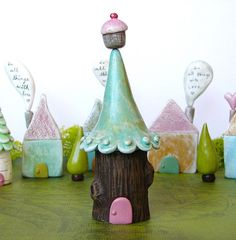 +Let the natural world inspire a woodland wonderland landscape, incorporate the shape and design of tree trunks, flowers, vines, moss, etc. Whimsical clay treehouse