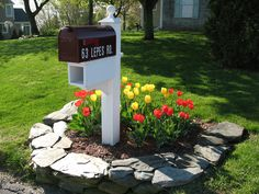 black-mailbox-in-flower-plot