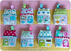 fabric houses...these look a bit involved...but oh so cute