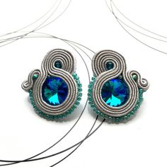 Stud earrings made in soutache technique. Delicate jewelry with faceted glass crystals. I used sparkling blue/green beads with addition of gray soutache braid. This pair will be great as a subtle addition to any outfit. I made them using the best quality materials with big attention to Delicate Jewelry, Boho Jewelry, Jewelery, Unique Jewelry, Blue Earrings, Tassel Earrings, Turquoise Necklace, Soutache Necklace, Faceted Glass