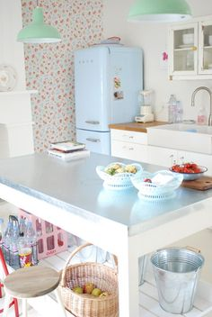 pastel colors in laundry, blue fridge, white legs on table, softer colors.