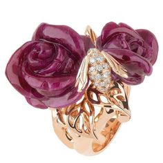 House of Dior.... Large Rose ring from Pre Catalan collection. The rings are made in 18kt yellow gold, with diamonds and red sculptured coral